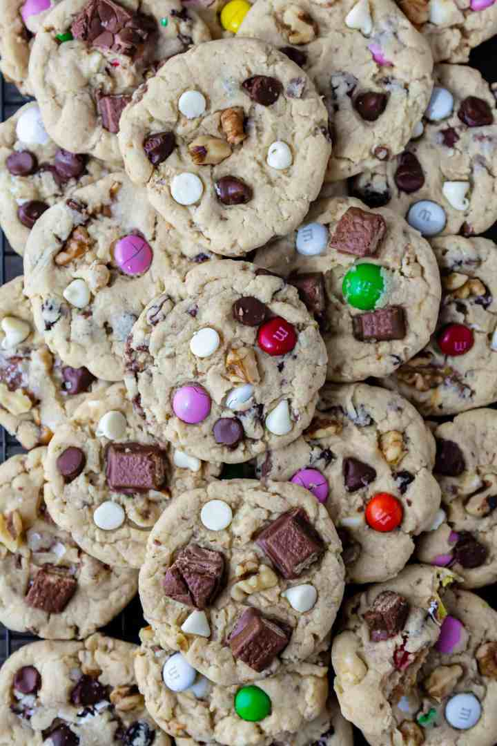 stack of Eggless Kitchen Sink Cookies loaded with choc chips, M&M's walnuts, raisins.