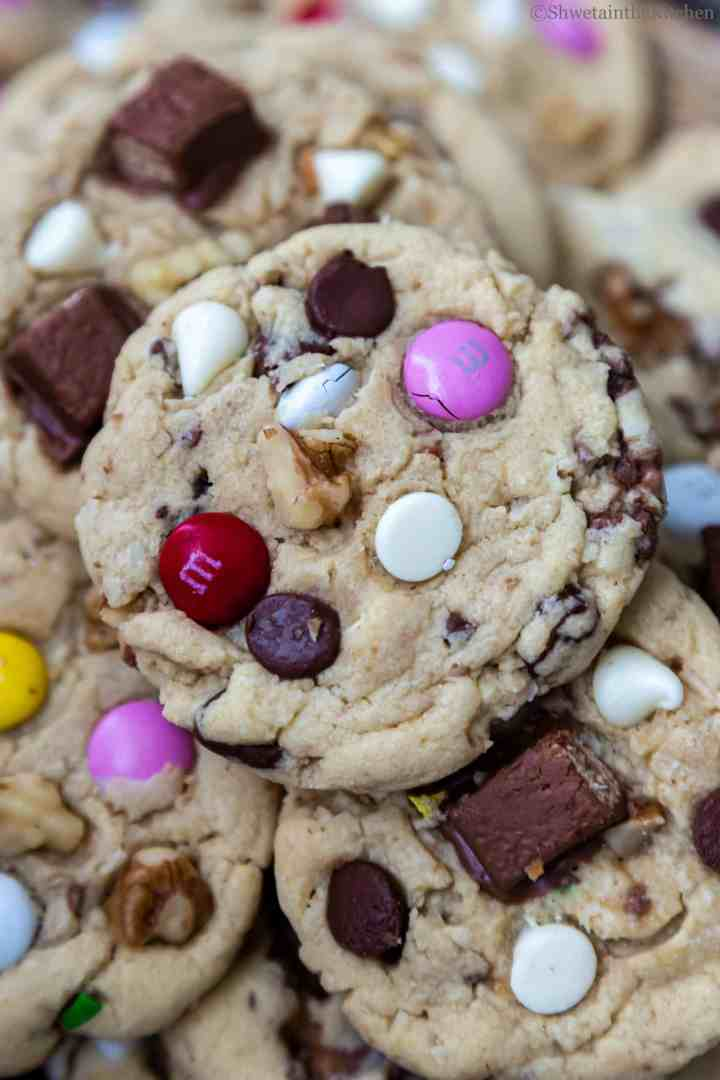 zoomed in view of Eggless Kitchen Sink Cookies showing chocolate chips, walnuts and M&M's