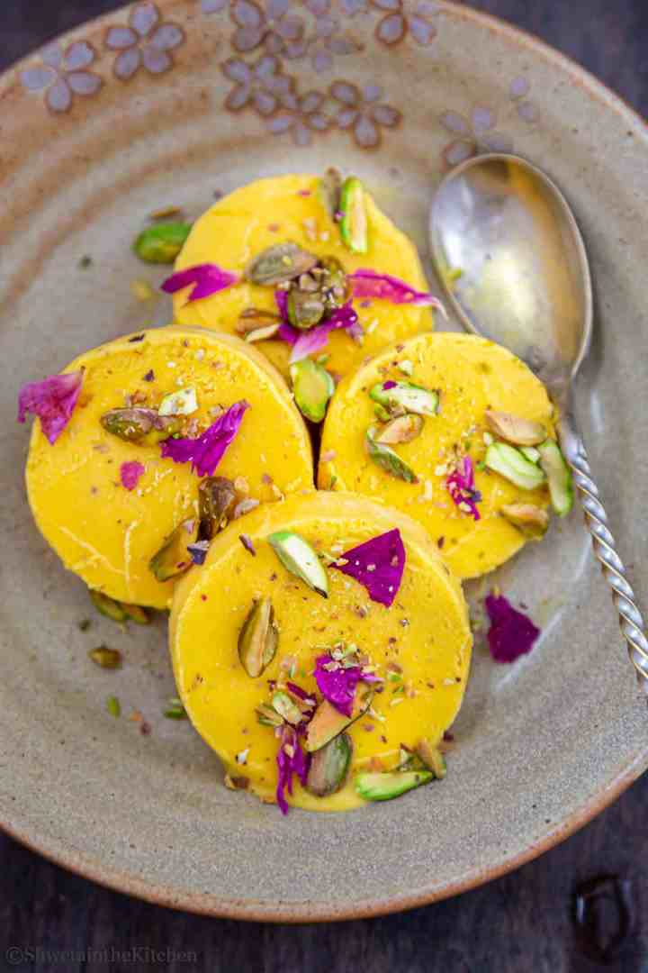 Sliced kulfi pieces of plate with spoon on side