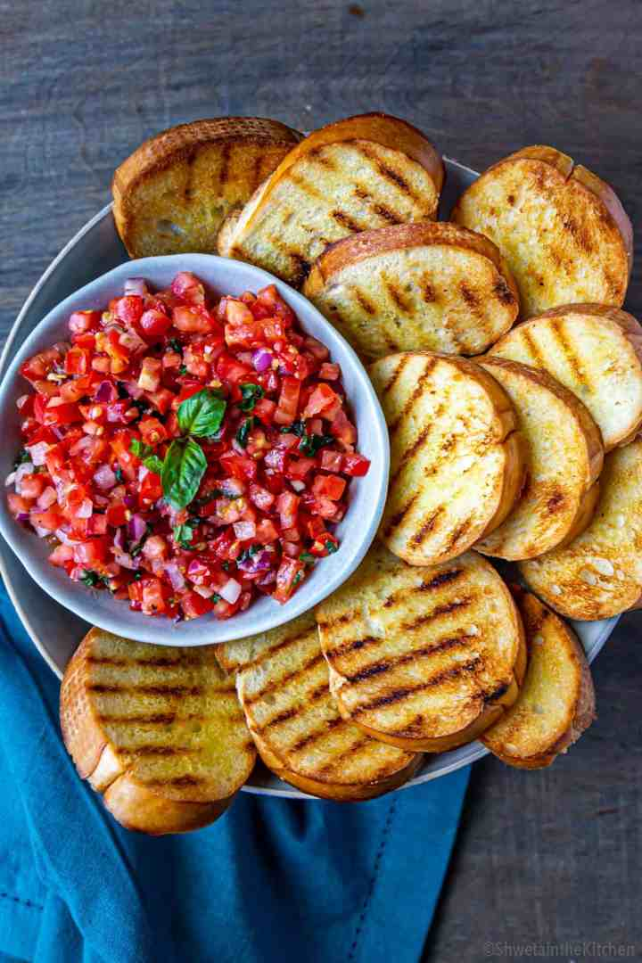 Tomato basil mixture surrounded by grilled bread
