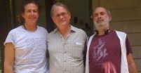 Dr. Rick Frires and Jagadish Visnauskas celebrate a full moon charity event with Shyamdas