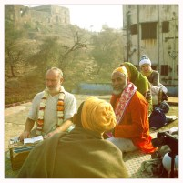 Singing on the roof in Jatipura, with Girirajji in the background