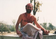 Ready to bathe at the well post-Holi