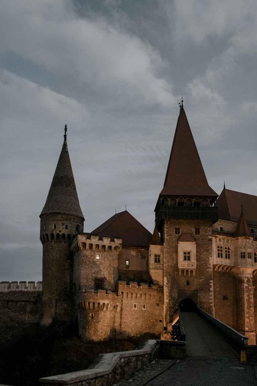 medieval stone castle under gloomy sky