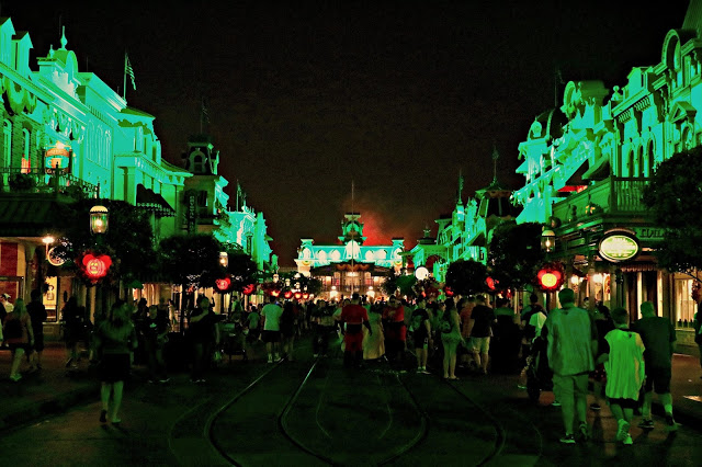 Main Street lit in green during Mickey's Not so Scary Halloween Party
