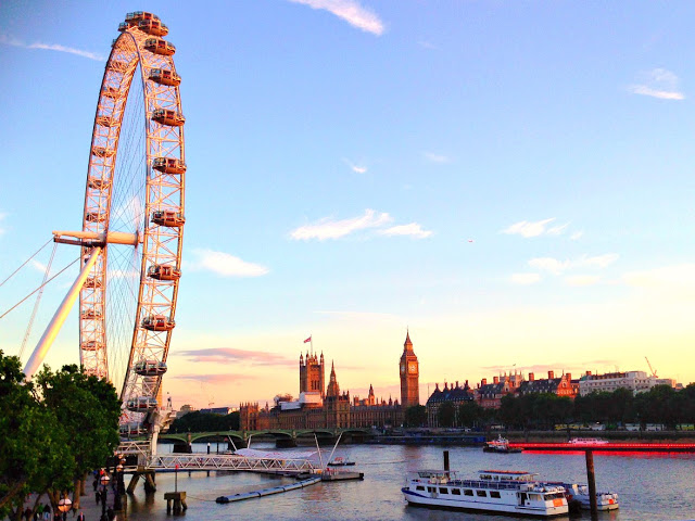 london eye and houses of parliament at sunset