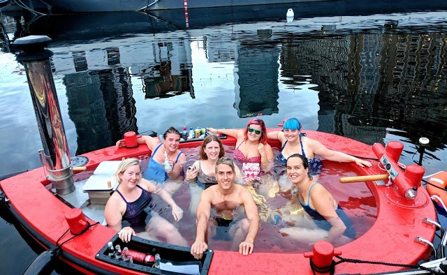 group of friends inside the HotTug