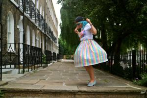 girl in a colourful skirt spinning in the street