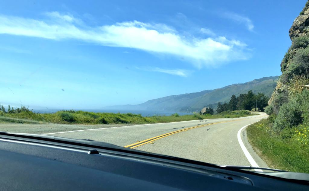 big sur roads as seen from inside a car on a road trip