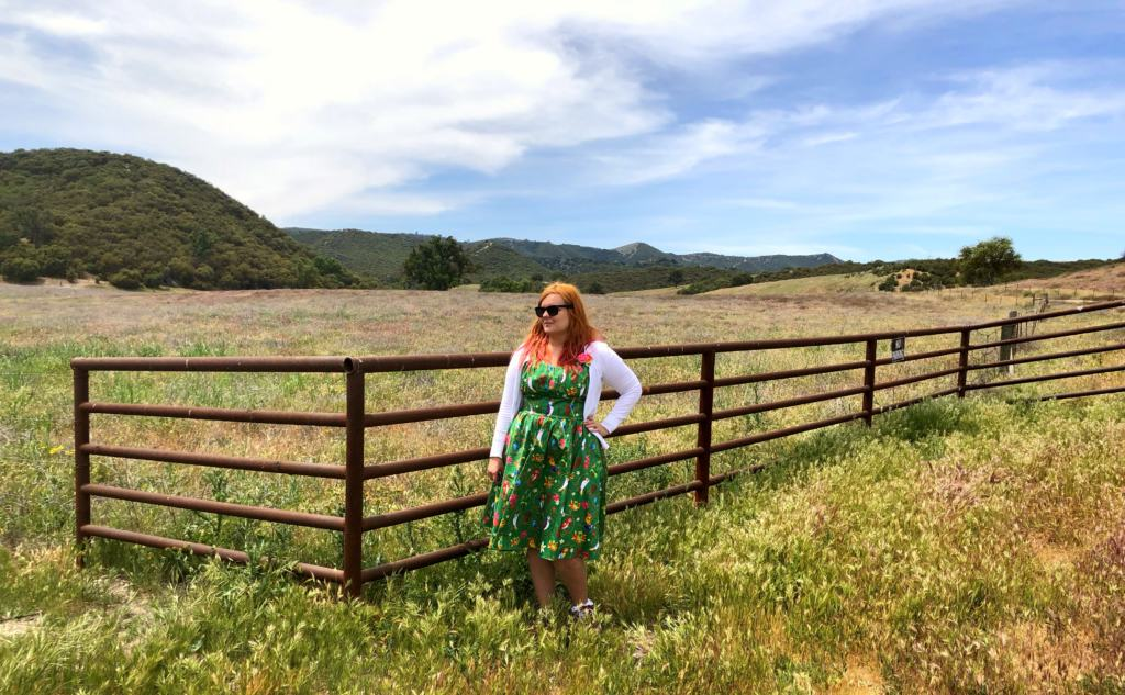 woman in green dress on a ranch near the big sur