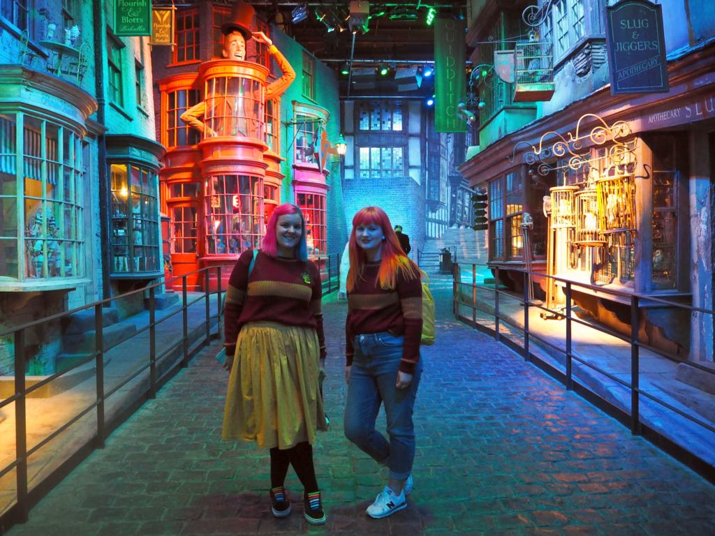 Two women in Griffendor uniforms in the Diagon Alley set at the Warner Bros. Studio tour