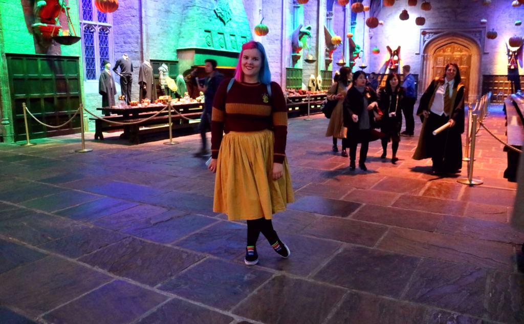 irl in Hogwarts uniform in the great hall in the Warner Bros. Studio
