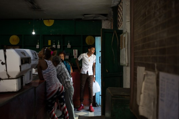 A teenager waiting last week at a Havana rations shop where Cubans receive dried goods using a state-issued booklet.