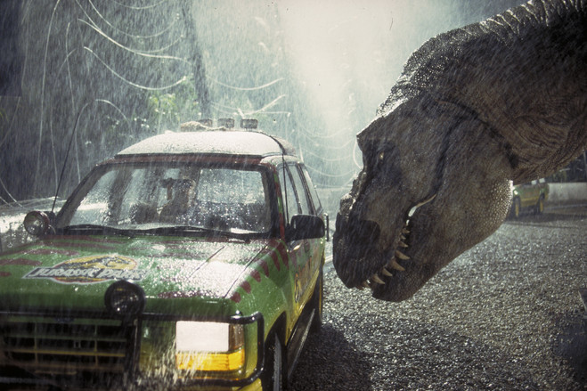 A Tyrannosaurus Rex menaces the theme park's first customers in a scene from 1993's 'Jurassic Park.'