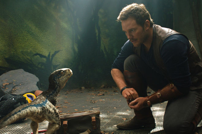 'Jurassic World: Fallen Kingdom' uses puppeteer-wielded dinosaurs in scenes such as one where Chris Pratt, as Owen Grady, interacts with baby raptors. 'They were able to play,' says special-effects supervisor Neal Scanlan. 'At one point, the puppeteer snapped at his finger, and Chris reacted to that in a completely real way.'