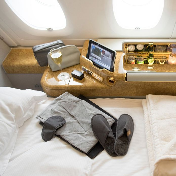 A selection of amenities in an Emirates Airline first-class cabin.