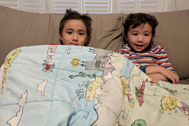 The children of frequent transatlantic flier Steve King relax with a blanket he swiped from Norwegian Air.