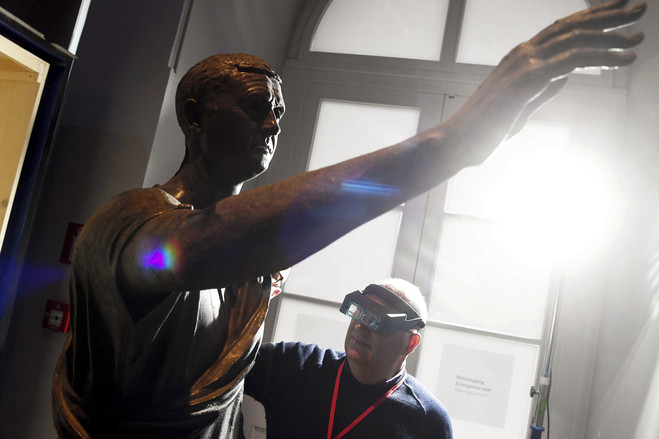 Dr. Mario Iozzo, director of the National Archaeological Museum in Florence, shown checking an Etruscan bronze statue.