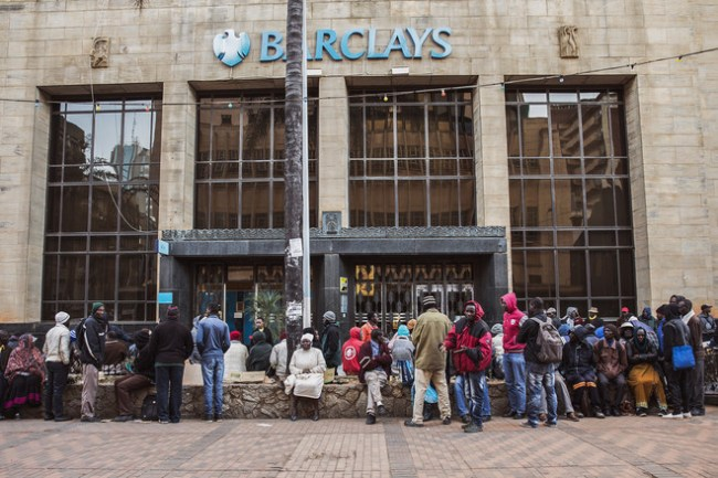 Bank customers line up outside a bank in central Harare in the hopes of withdrawing increasingly rare U.S. dollars.