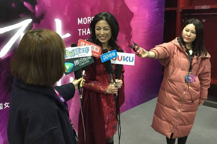 Joy Chen, center, is interviewed by Chinese reporters in Beijing, where she spoke at the China Women in Leadership forum in March.