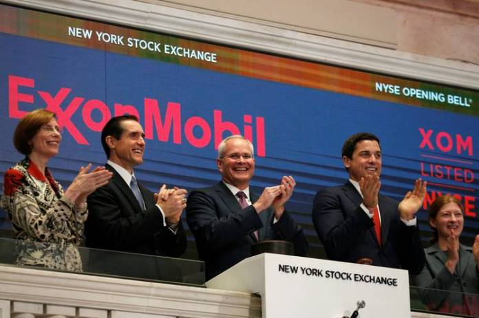 Exxon CEO Darren Woods, center, at the New York Stock Exchange last year.