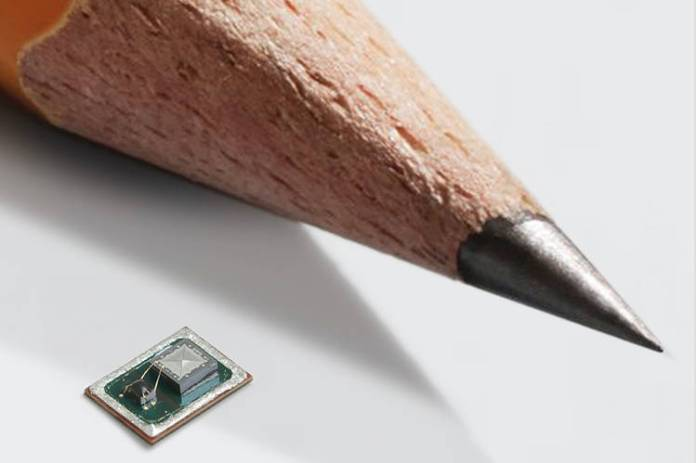 Vesper's tiny piezoelectric MEMS microphones next to a pencil.