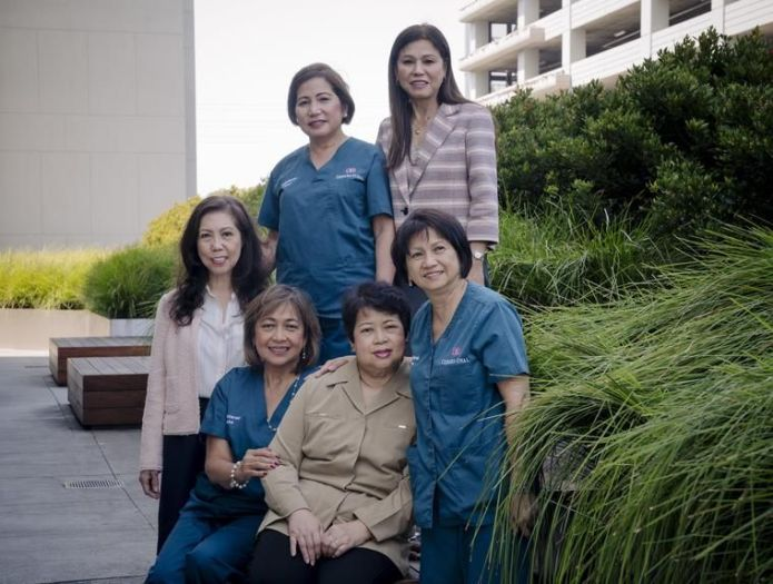 The women recently gathered in Los Angeles at Cedars-Sinai, where five of them still work. Clockwise from bottom right: Nora Levid, Connie Arostegui (in beige), Teresa Santos, Joyette Jagolino, Gertrudes Tan and Peachy Hain.