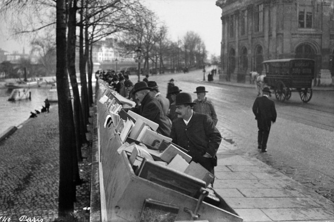 Booksellers at the end of the 19th century in the Sixth Arrondissement on the Left Bank, when authorities began charging them to leave crates in place overnight.