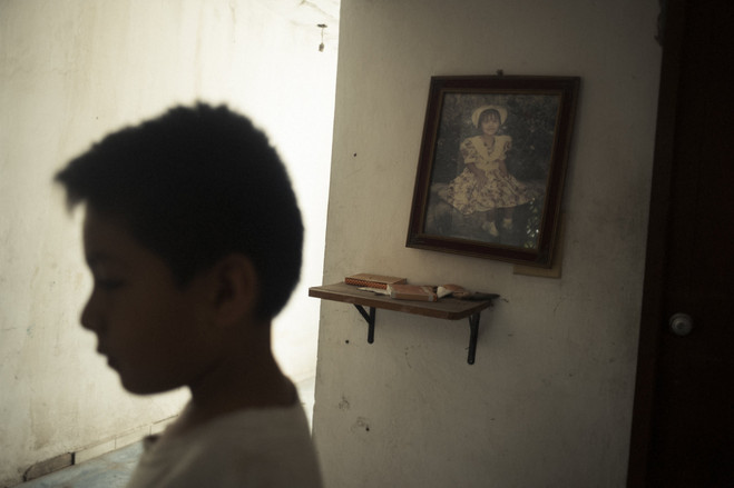 Six-year-old Elias Victoria with a photo of his older sister Erica.  Latin America Is the Murder Capital of the World B3 BU524 0917la H 20180917231928