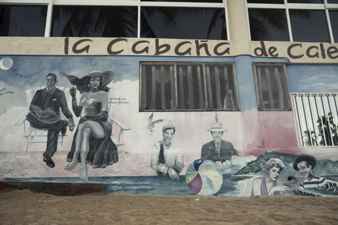 A mural depicting a more prosperous time in Acapulco at a now-empty beach.  Latin America Is the Murder Capital of the World B3 BU528 0917la H 20180917231928