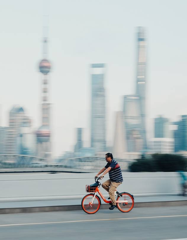 Bike-sharing startup Mobike, whose wheels are seen here in Shanghai on a recent day, recently sold itself for nearly $1 billion less than it was valued after its last funding round.