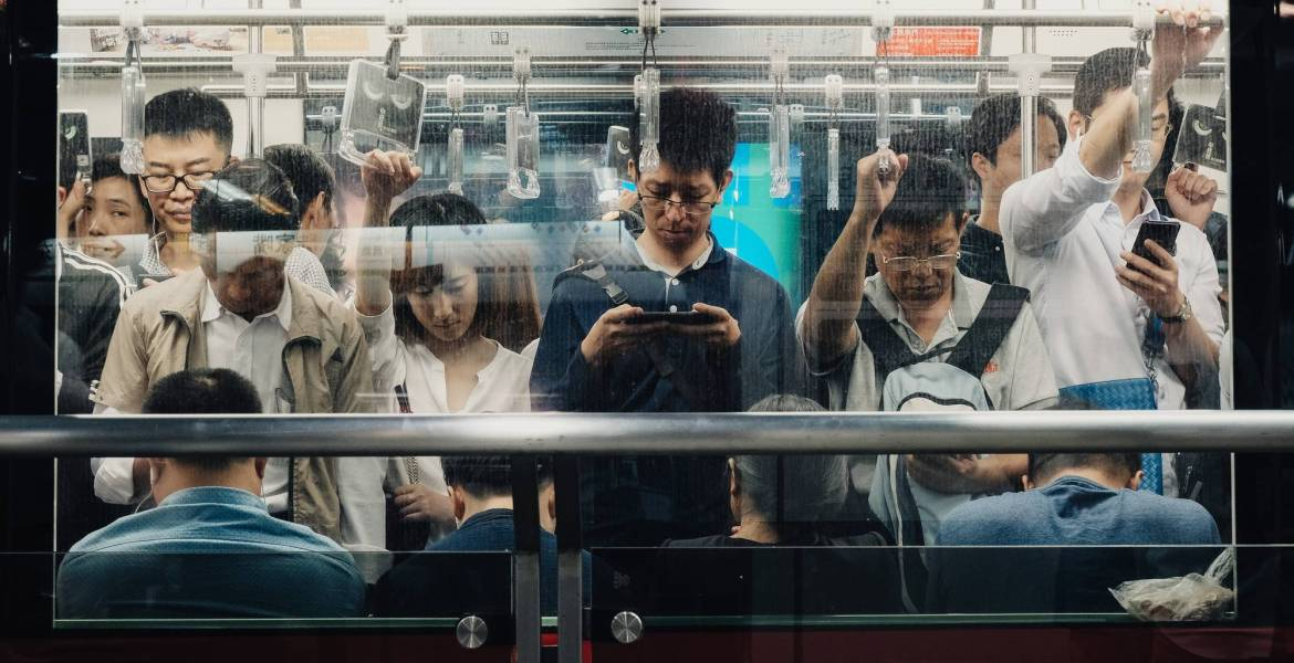 Believers in China's tech boom say the opportunities are large enough to justify lofty valuations. Here, riders on Shanghai's subway during rush hour.