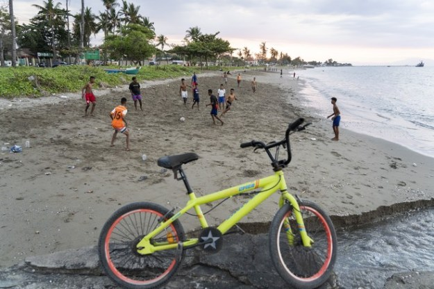 People play on the beach in Dili, the capital of East Timor.