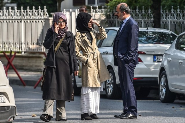 Jamal Khashoggi's Turkish fiancée Hatice Cengiz, left, and her friends wait in front of the Saudi Arabian consulate in Istanbul on Oct. 3.