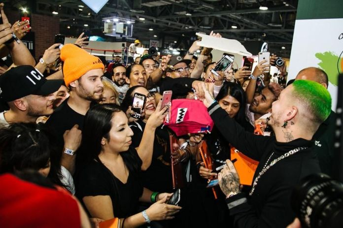 Celebrities like Colombian singer J. Balvin (far right, with green hair) drew chaotic crowds as fans jockeyed for autographs and selfies.