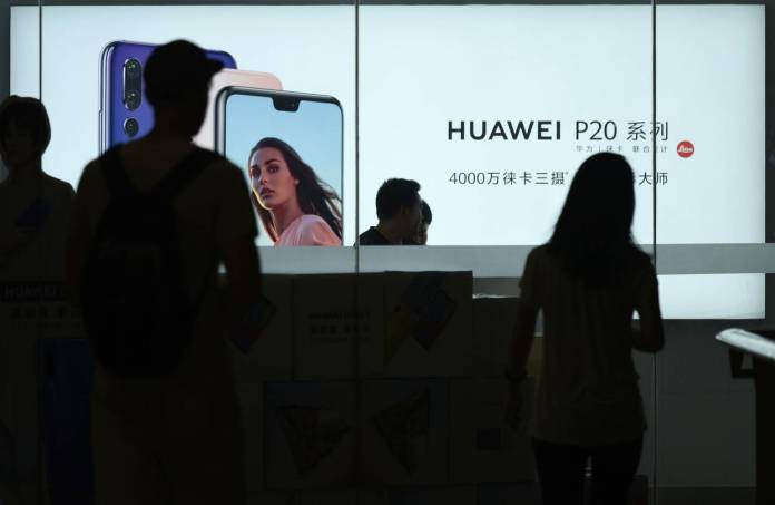 The arrest Wednesday of a senior Huawei executive intensified trade negotiations. Here, a Huawei store in Beijing.