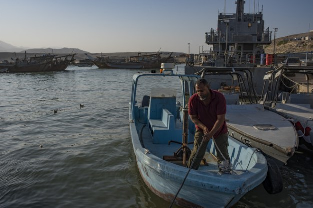 A fisherman in the port of Nishtoon works next to the Yemeni coast guard, which Saudi Arabia has supported to combat smuggling of weapons and drugs.