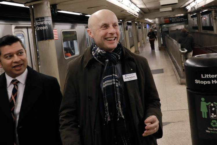 Andy Byford, right, oversees an agency of 50,000 employees who help to carry more than 7 million daily riders.