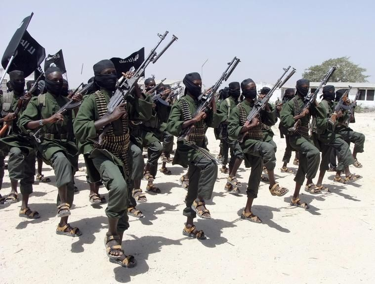 Hundreds of newly trained al-Shabab fighters perform military exercises just south of Mogadishu in 2011.