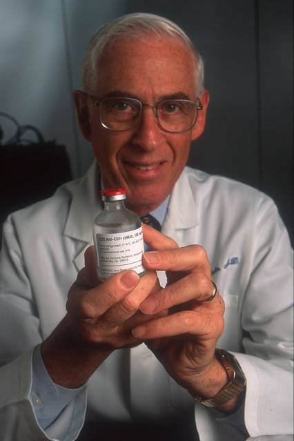 Dr. John Mendelsohn, discoverer of the C225 at the University of Texas MD Anderson Cancer Center, with a vial of treatment.