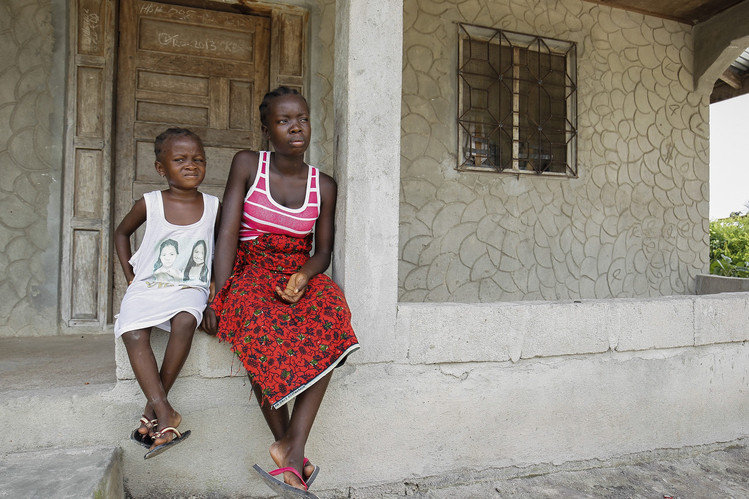 Orphaned Liberians Dianna Powell, left, and Tina Powell survived the Ebola virus but lost both parents and six other relatives to the disease at the New Dolos Town Community in Margibi County, Liberia.