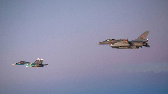 A Russian Air Force Su-34 Fullback strike aircraft, left, is escorted by a Norwegian Air Force jet in this Oct. 31, 2014, photo released by the Norwegian Air Force.