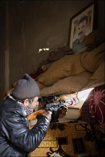A Syrian Kurdish fighter defends his position in Kobani.
