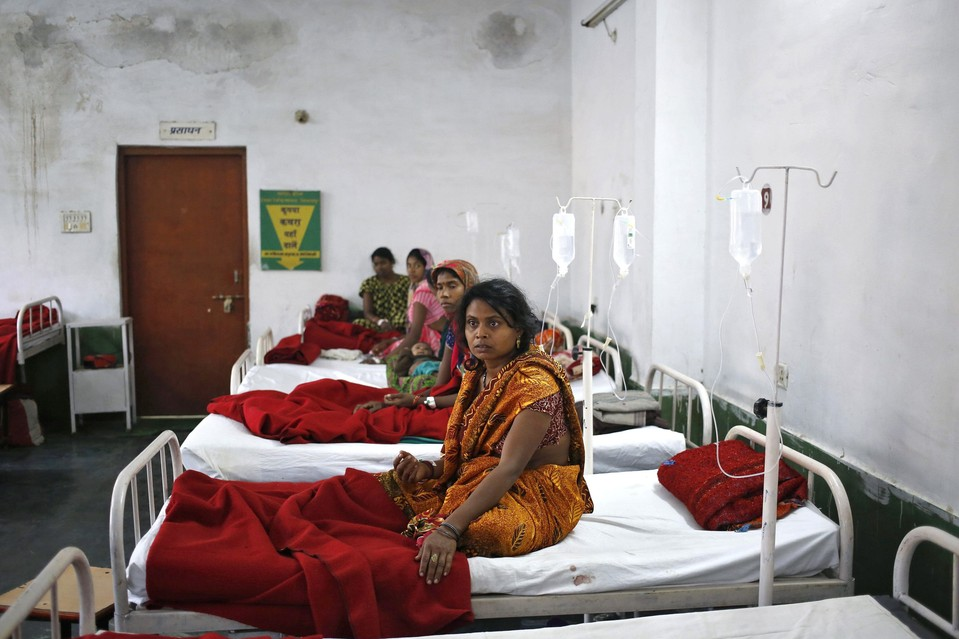 Women who underwent a sterilization surgery at a government surgery camp lie in beds for treatment at the Chhattisgarh Institute of Medical Sciences hospital in the city of Bilaspur last month.