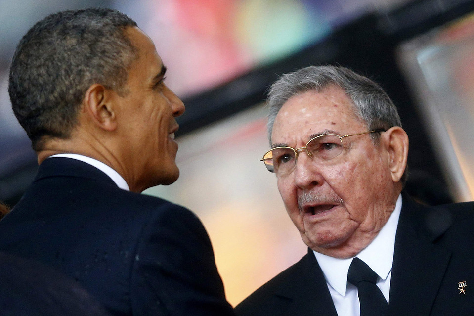 U.S. President Barack Obama (L) greets Cuba's President Raul Castro before giving his speech at the memorial service for late South African President Nelson Mandela in Johannesburg in this December 10, 2013 file photo.