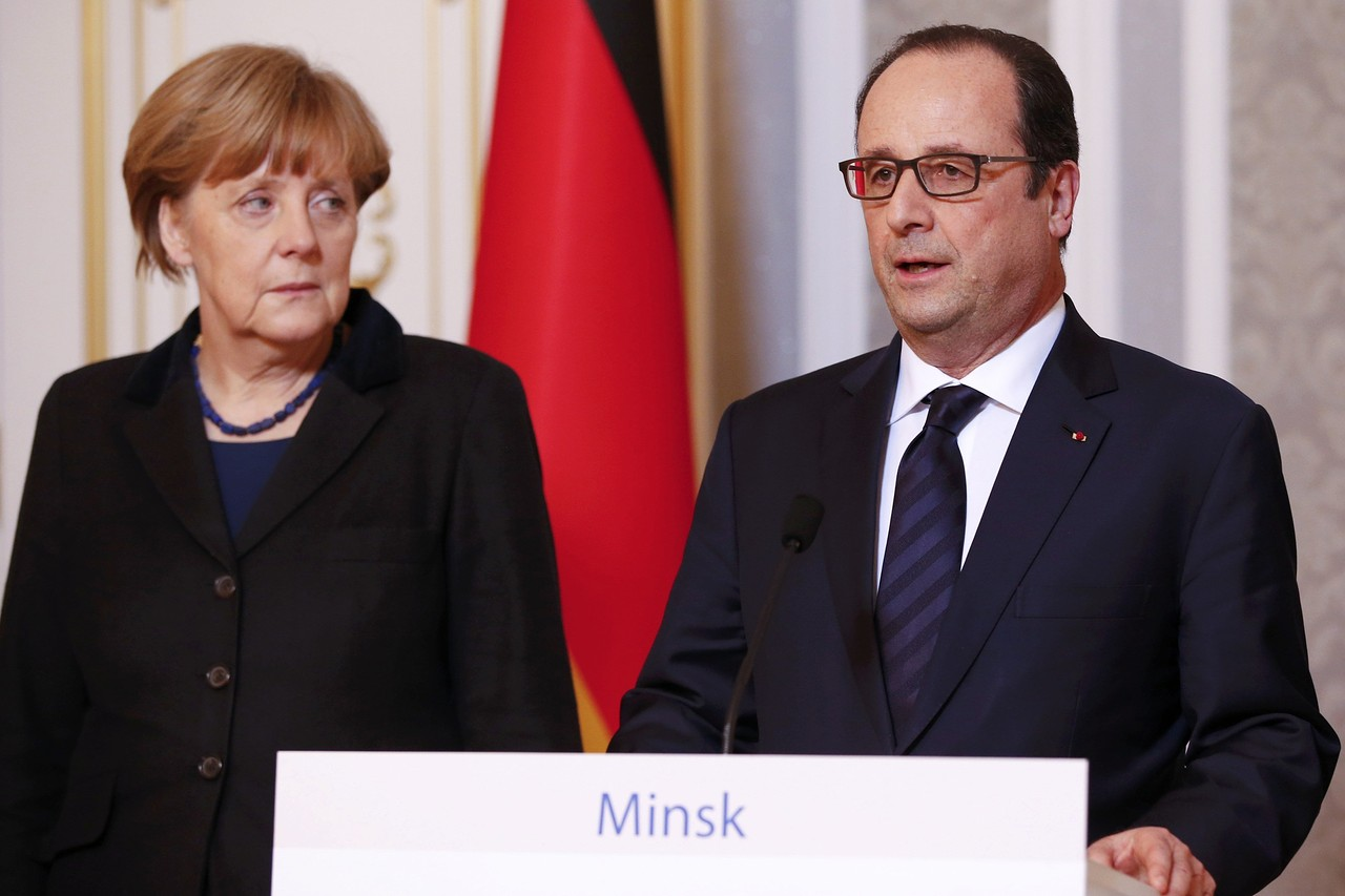 German Chancellor Angela Merkel, left, and French President François Hollande address the media after peace talks in Minsk on resolving the Ukraine crisis on Thursday.