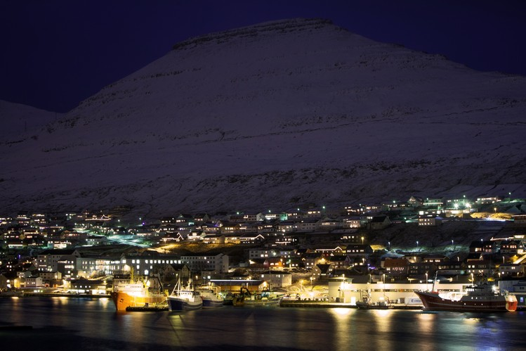 A view of a small fishing village in the Faeroe Islands as evening falls.