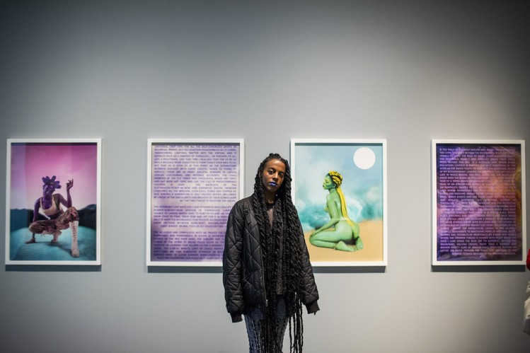 Artist Juliana Huxtable poses in front of her artwork at the New Museum Triennial.
