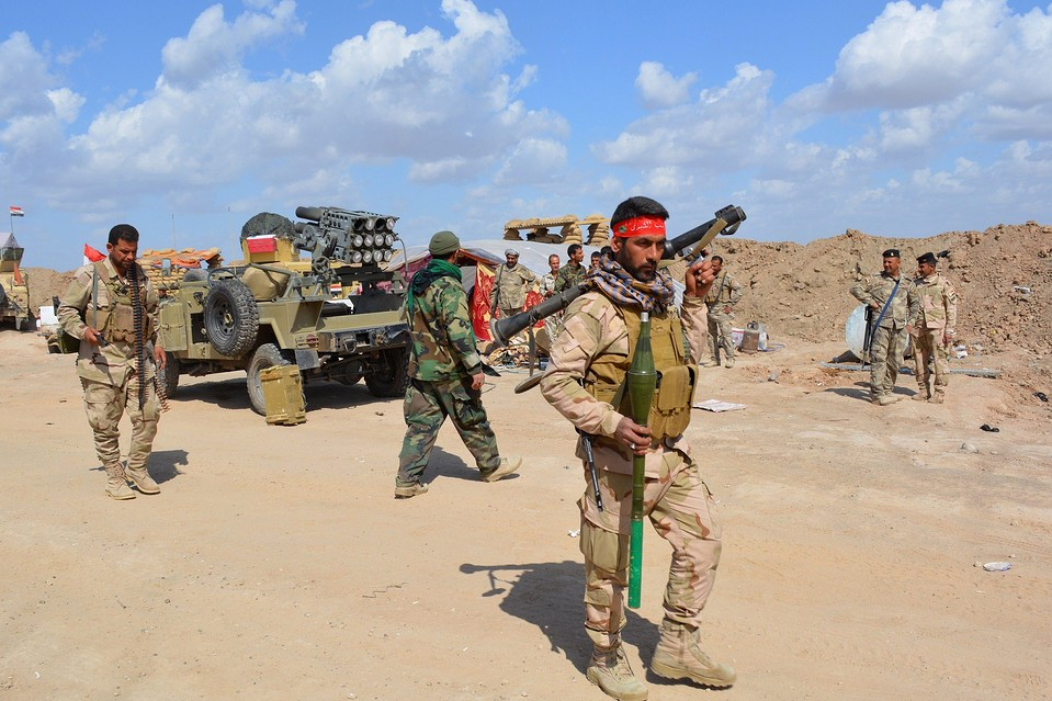 Iraqi forces and allied militias take position in the northern part of Diyala province as they take part in an assault to retake the city of Tikrit from Islamic State jihadists Monday.