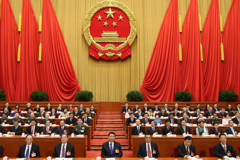 Chinese President Xi Jinping, front center, and other Chinese leaders attend the opening meeting on Thursday of the third session of the National People's Congress at the Great Hall of the People in Beijing.